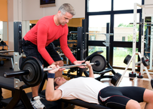 spotter helping man workout tips for men