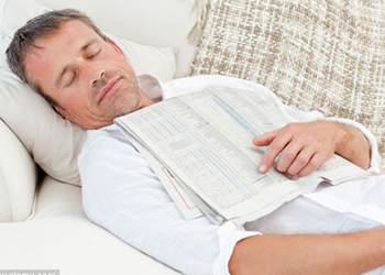 man sleeping on couch holistic health