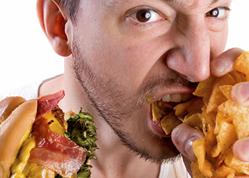 man binge eating don't over eat principles of muscle buidling