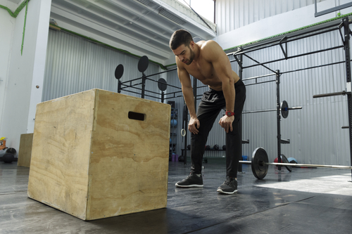 man preparing to jump on box power workout for men